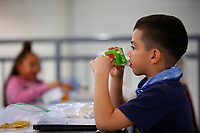 Laith Cook, 8, drinks apple juice at the table at the Boys and Girls Club of Western Pennsylvania in the Lawrenceville neighborhood on Friday February 19, 2021 in Pittsburgh, Pennsylvania. (Photo by Jared Wickerham/Pittsburgh City Paper)