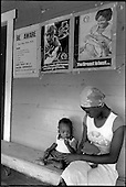 A mother and baby wait at a monthly family planning clinic held at Crochu Medical Station by the Grenada Planned Parenthood Association.  During the rule of the People's Revolutionary Government many health centres were staffed by Cuban doctors.