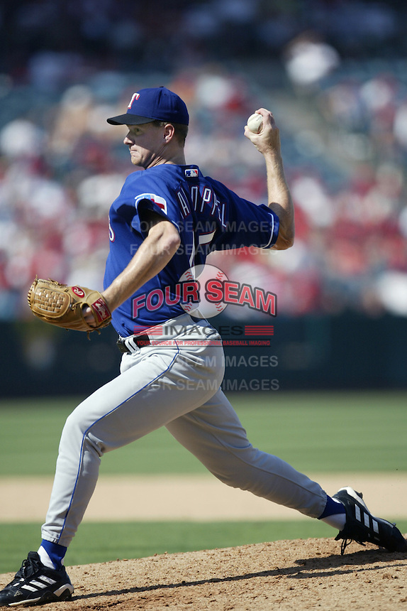 Todd Van Poppel of the Texas Rangers pitches during a 2002 MLB season game against the Los Angeles Angels at Angel Stadium, in Los Angeles, California. (Larry Goren/Four Seam Images via AP Images)