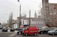 Milano, un furgone dei Vigili del Fuoco davanti a un cartellone pubblicitario della rivista per adulti Playboy --- Milan, a van of the Fire Brigade in front of an advertising of the adults magazine Playboy
