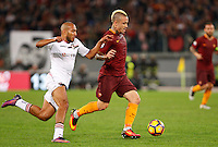 Calcio, Serie A: Roma vs Palermo. Roma, stadio Olimpico, 23 ottobre 2016.<br /> Roma's Radja Nainggolan, right, is challenged by Palermo's Haitam Aleesami during the Italian Serie A football match between Roma and Palermo at Rome's Olympic stadium, 23 October 2016. Roma won 4-1.<br /> UPDATE IMAGES PRESS/Riccardo De Luca