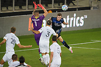 SAN JOSE, CA - OCTOBER 03: David Bingham #1 of the Los Angeles Galaxy defends Tanner Beason #15 of the San Jose Earthquakes during a game between Los Angeles Galaxy and San Jose Earthquakes at Earthquakes Stadium on October 03, 2020 in San Jose, California.