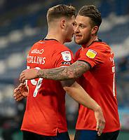 7th November 2020 The John Smiths Stadium, Huddersfield, Yorkshire, England; English Football League Championship Football, Huddersfield Town versus Luton Town; James Collins of Luton Town  celebrates with George Moncur of Luton Town  after his 21st minute opening goal for Luton