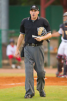 Home plate umpire Luke Engen during an Appalachian League game between the Greeneville Astros and the Elizabethton Twins at Joe O'Brien Field August 15, 2010, in Elizabethton, Tennessee.  Photo by Brian Westerholt / Four Seam Images