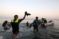 Greece/Lesvos island/August 17,2008.A migrant yelling with joy as he finally made it to cross into Europe. He has just arrived in Korakas Cape in the island of Lesvos located in Aegean Sea, 7 miles away from the Turkish coast.The Greek-Turkish (sea and land) borders are of particular interest as they constitute, today, the main entry route to southeast Europe for thousands aliens. Groups of bedraggled men, women and children from as far away as Afghanistan, Syria, Iraq, Somalia and various countries in Asia, the Middle East and Africa arrive daily with the hope to find a better future. Hundrends have drowned in the Aegean Sea, that has come to be characterized as an aquatic grave for immigrants. Giorgos Moutafis