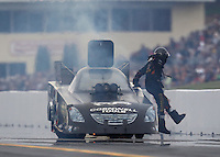 Oct 2, 2016; Mohnton, PA, USA; NHRA funny car driver Jim Campbell climbs out the emergency roof escape hatch after an engine fire during the Dodge Nationals at Maple Grove Raceway. Mandatory Credit: Mark J. Rebilas-USA TODAY Sports