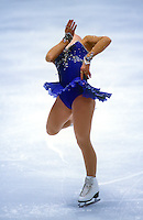 A female figure skater in action during competiton.