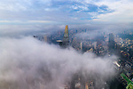 Pictured: One of the world's tallest buildings stretches above a city shrouded in thick fog   The 461 metre-tall Landmark 81 was almost the only structure visible as clouds swirled around Ho Chi Minh City, Vietnam.<br /> <br /> Photographer Trung Anh, who is based in the city, captured remarkable images of the early morning phenomenon using a drone.  Other than Landmark 81, which is the tallest building in South East Asia, the only other building able to pierce the summer fog was the 263 metre Bitexco Financial Tower.   SEE OUR COPY FOR DETAILS<br /> <br /> Please byline: Trung Anh/Solent News<br /> <br /> © Trung Anh/Solent News & Photo Agency<br /> UK +44 (0) 2380 458800