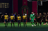 ATLANTA, GA - APRIL 27: Referees and Atlanta United starters enter the field of play prior to a CONCACAF Champions League game between Philadelphia Union and Atlanta United FC at Mercedes-Benz Stadium on April 27, 2021 in Atlanta, Georgia.
