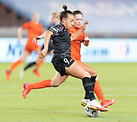 HOUSTON, TX - SEPTEMBER 10: Mallory Pugh #9 of the Chicago Red Stars attempts to control the ball with Allysha Chapman #2 of the Houston Dash right beside her during a game between Chicago Red Stars and Houston Dash at BBVA Stadium on September 10, 2021 in Houston, Texas.