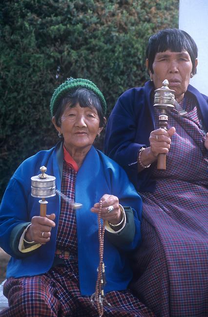Women with Prayer Wheels, Bhutan
