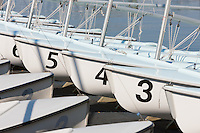 Part of the fleet of US Navy training sailboats moored at Santee Basin adjacent to the Robert Crown Sailing Center at the US Naval Academy in Annapolis, Maryland.