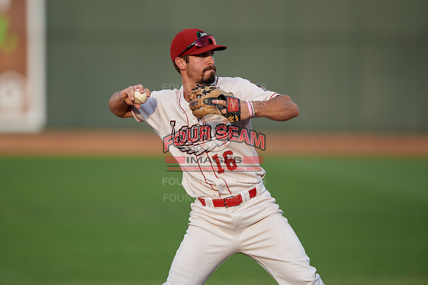 Great Lakes Loons third baseman Luke Heyer (16) throws to first base during a Midwest League game against the Clinton LumberKings on July 19, 2019 at Dow Diamond in Midland, Michigan.  Clinton defeated Great Lakes 3-2.  (Mike Janes/Four Seam Images)