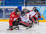 Sochi, RUSSIA - Mar 13 2014 - Ben Delaney as Canada takes on USA in Sledge Hockey Semi-Final at the 2014 Paralympic Winter Games in Sochi, Russia.  (Photo: Matthew Murnaghan/Canadian Paralympic Committee)