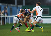 Peter Lydon of London Scottish Football Club is tackled during the Greene King IPA Championship match between London Scottish Football Club and Ealing Trailfinders at Richmond Athletic Ground, Richmond, United Kingdom on 26 December 2015. Photo by Alan  Stanford / PRiME Media Images