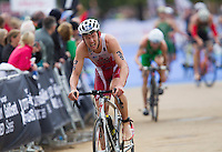15 SEP 2013 - LONDON, GBR - Andrew Yorke (CAN) of Canada exits transition for the start of the bike during the elite men's ITU 2013 World Triathlon Series Grand Final in Hyde Park, London, Great Britain (PHOTO COPYRIGHT © 2013 NIGEL FARROW, ALL RIGHTS RESERVED)