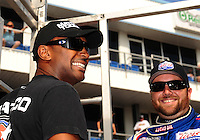Sept. 25, 2011; Ennis, TX, USA: NHRA top fuel dragster driver Antron Brown (left) with Shawn Langdon during the Fall Nationals at the Texas Motorplex. Mandatory Credit: Mark J. Rebilas-