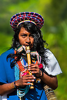 """A native from the Kamentsá tribe, wearing a colorful headgear, plays flute during the Carnival of Forgiveness, a traditional indigenous celebration in Sibundoy, Colombia, 12 February 2013. Clestrinye (""""Carnaval del Perdón"""") is a ritual ceremony kept for centuries in the Valley of Sibundoy in Putumayo (the Amazonian department of Colombia), a home to two closely allied indigenous groups, the Inga and Kamentsá. Although the festival has indigenous origins, the Catholic religion elements have been introduced and merged with the shamanistic tradition. Celebrating annually the collaboration, peace and unity between tribes, they believe that anyone who offended anyone may ask for forgiveness this day and all of them should grant pardons."""