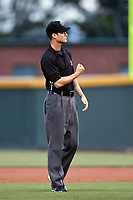 Field umpire Mike Bass works a game between the Greenville Drive and Lexington Legends on Friday, June 30, 2017, at Fluor Field at the West End in Greenville, South Carolina. Lexington won, 17-7. (Tom Priddy/Four Seam Images)