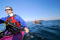 Point of View shot POV of male paddlers , Sea Kayaking the San Juan Islands, WA.