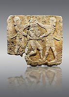 Hittite relief sculpted orthostat stone panel of Herald's Wall Limestone, Karkamıs, (Kargamıs), Carchemish (Karkemish), 900-700 B.C. Anatolian Civilisations Museum, Ankara, Turkey.<br /> <br /> This relief tells the story the killing of Humbaba, protective deity of the cedar forests, by Gilgamesh and Enkidu. The figures standing on both sides hold, with one hand, the arms of the figure in the middle transversally while they stab the dagger on the head of the figure.