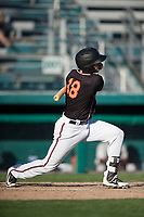 Modesto Nuts first baseman Evan White (18) follows through on his swing during a California League game against the San Jose Giants at John Thurman Field on May 9, 2018 in Modesto, California. San Jose defeated Modesto 9-5. (Zachary Lucy/Four Seam Images)