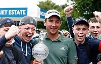 4th July 2021; Mount Juliet Golf Club, Kilkenny, Ireland; Dubai Duty Free Irish Open Golf, Day Four; Lucas Herbert of Australia poses with the winners trophy with spectators