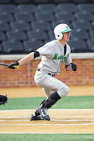 Corey Bird (31) of the Marshall Thundering Herd follows through on his swing against the Wake Forest Demon Deacons at Wake Forest Baseball Park on February 17, 2014 in Winston-Salem, North Carolina.  The Demon Deacons defeated the Thundering Herd 4-3.  (Brian Westerholt/Four Seam Images)