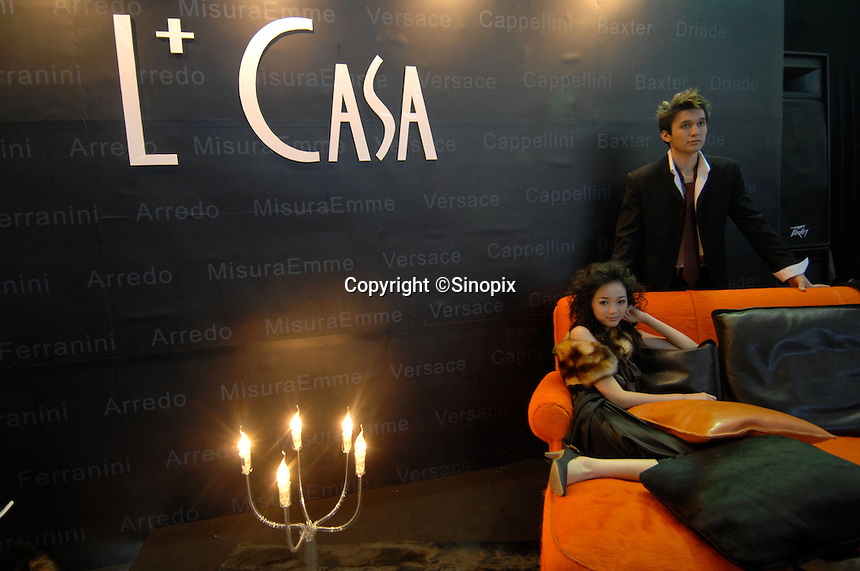 """A model sits on a designer sofa at """"L+ Casa"""" interior designers at the """"Top Show"""" luxury goods fair in Shenzhen, China..18 Dec 2006"""
