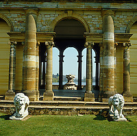 The classical colonnade guarded by stone lions in the gardens of Hever Castle