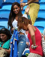 Fanny Neguesha, the fiancee of Mario Balotelli of Italy, waves to photographers before kick off