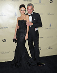 Danny Huston and Olga Kurylenko at THE WEINSTEIN COMPANY 2013 GOLDEN GLOBES AFTER-PARTY held at The Old trader vic's at The Beverly Hilton Hotel in Beverly Hills, California on January 13,2013                                                                   Copyright 2013 Hollywood Press Agency