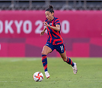 KASHIMA, JAPAN - AUGUST 5: Christen Press #11 of the USWNT dribbles during a game between Australia and USWNT at Kashima Soccer Stadium on August 5, 2021 in Kashima, Japan.