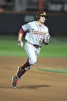 Florida State Seminoles center fielder Brett Knief #23 runs to third during a game against the Clemson Tigers at Doug Kingsmore Stadium on March 22, 2014 in Clemson, South Carolina. The Seminoles defeated the Tigers 4-3. (Tony Farlow/Four Seam Images)