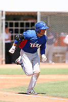 Leonys Martin #22 of the Texas Rangers plays in an extended spring training game against the Los Angeles Dodgers at the Rangers minor league complex on May 7, 2011  in Surprise, Arizona. Martin recently signed a five-year deal with the Rangers worth $15.5 million after defecting from his native Cuba..Photo by:  Bill Mitchell/Four Seam Images.