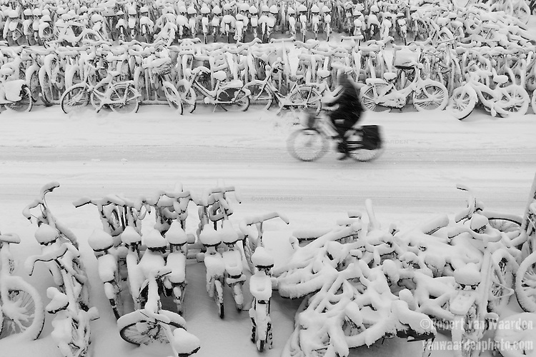The snow covered bikes of Amsterdam in Holland