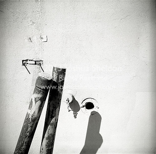 Shadow of pipes on wall<br />