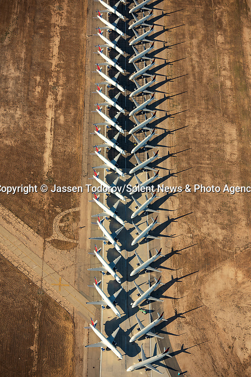 Pictured:  Hundreds of 'furloughed'passenger jets are lined up just metres away from each other in California, USA.<br /> <br /> Amazing aerial photos show off the majesty of America's landscape, its architecture, its industry and its wildlife.   From the startling blue potash pools of Utah to hundreds of aircraft sitting unused due to the pandemic, the images display a little seen side of the USA.<br /> <br /> Other images include a passenger plane plane as it touches down in California taken 4,500ft above it, fog over the Golden Gate Bridge and a solar farm in Nevada.   Professor of Music Jassen Todorov, from San Francisco, captured the striking pictures of the American West while flying in a light aircraft.   SEE OUR COPY FOR DETAILS<br /> <br /> Please byline: Jassen Todorov/Solent News<br /> <br /> © Jassen Todorov/Solent News & Photo Agency<br /> UK +44 (0) 2380 458800