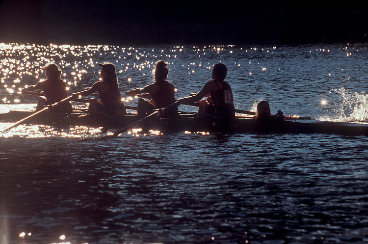 Rowing, Crew, Four rowers with cox silhouetted, Head of the Charles Regatta, Charles River, Cambridge, Boston, Massachusetts, New England, USA,.