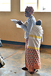 A workshop on maternal and newborn care for  women who are community health workers  from 36 villages at Ruhunda Health Center in eastern Rwanda.   ..The women listened to lectures, took a test, then sang and danced