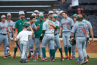 Chad Crosbie of the Miami Hurricanes is congratulated by his teammates after hitting a 3-run home run against the Wake Forest Demon Deacons at David F. Couch Ballpark on May 11, 2019 in  Winston-Salem, North Carolina. The Hurricanes defeated the Demon Deacons 8-4. (Brian Westerholt/Four Seam Images)