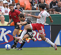 DC United midfielder Ben Olsen (14) tries to make a pass in front of New York Red Bulls midfielder Claudio Reyna (10). DC United defeated the New York Red Bulls, 4-2, at RFK Stadium in Washington DC, Sunday, June 10 , 2007.