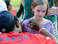 All-star infielder Angelys Nina of the Asheville Tourists signs the shirt of Avery Lomax, 8, of Greenville during the 2010 South Atlantic League All-Star Game welcome party and festivities Monday night June 21, 2010, at the Wyche Pavilion along the Reedy River in Greenville, S.C. The All-Star Game is Tuesday night at Fluor Field. Photo by: Tom Priddy/Four Seam Images