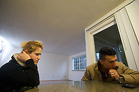 Shatha Sulaiman Kheder, 27, (center), and her husband Adil Kheder Nimr, 27, recollect family members still in Iraq during an interview in their new apartment in Tukwila, Wash. on January 30, 2017. The family including their son Steven Adil Kheder, 10 months, arrived in the United States on as refugees from Iraq on January 19, 2017, the day after Donald Trump was sworn in as the 45th president of the United States. They are concerned about thirteen of their family members still in Iraq. Trump signed an executive order last Friday restricting immigration from seven Muslim countries, suspending all refugee admission for 120 days, and bans all Syrian refugees indefinitely.  (Photo by Karen Ducey)