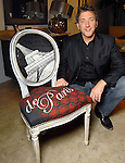 """Designer Ray Phillips with his chair titled """"Tout et Paris"""" at the Les Provinciales Design for a Cause event at Roche Bobois Thursday Dec. 10,2009.(Dave Rossman/For the Chronicle)"""