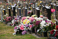 Flowers in a graveyard on Mothers' Day, Winsford, Cheshire.