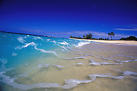 Waves breaking in clear blue water on white sand beach, Velzyland, North Shore, Oahu