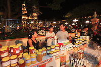 A beekeeper sells his honey at the evening market in Campeche.