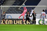 20th December 2020; Dragao Stadium, Porto, Portugal; Portuguese Championship 2020/2021, FC Porto versus Nacional; Daniel Guimarães of Nacional manages to collect the high cross