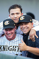 Charlotte Knights hitting coach Andy Tomberlin (left), Carlos Sanchez (top) and Miguel Gonzalez (23) pose for a photo prior to the game against the Gwinnett Braves at BB&T Ballpark on August 19, 2014 in Charlotte, North Carolina.   (Brian Westerholt/Four Seam Images)